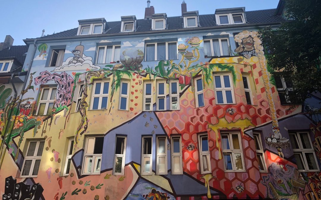 Colorful painted apartment building covered in art