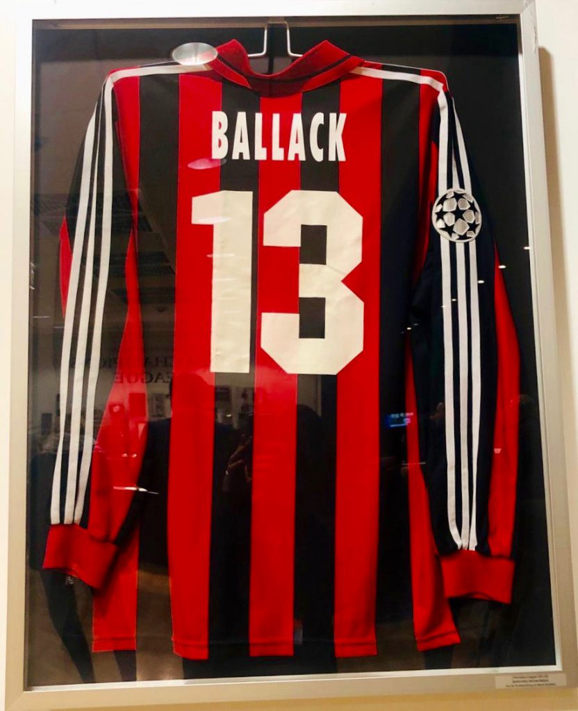 A framed football shirt from Number 13 Michael Ballack