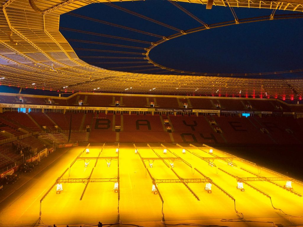 View inside the Bayarena with floodlights on the pitch