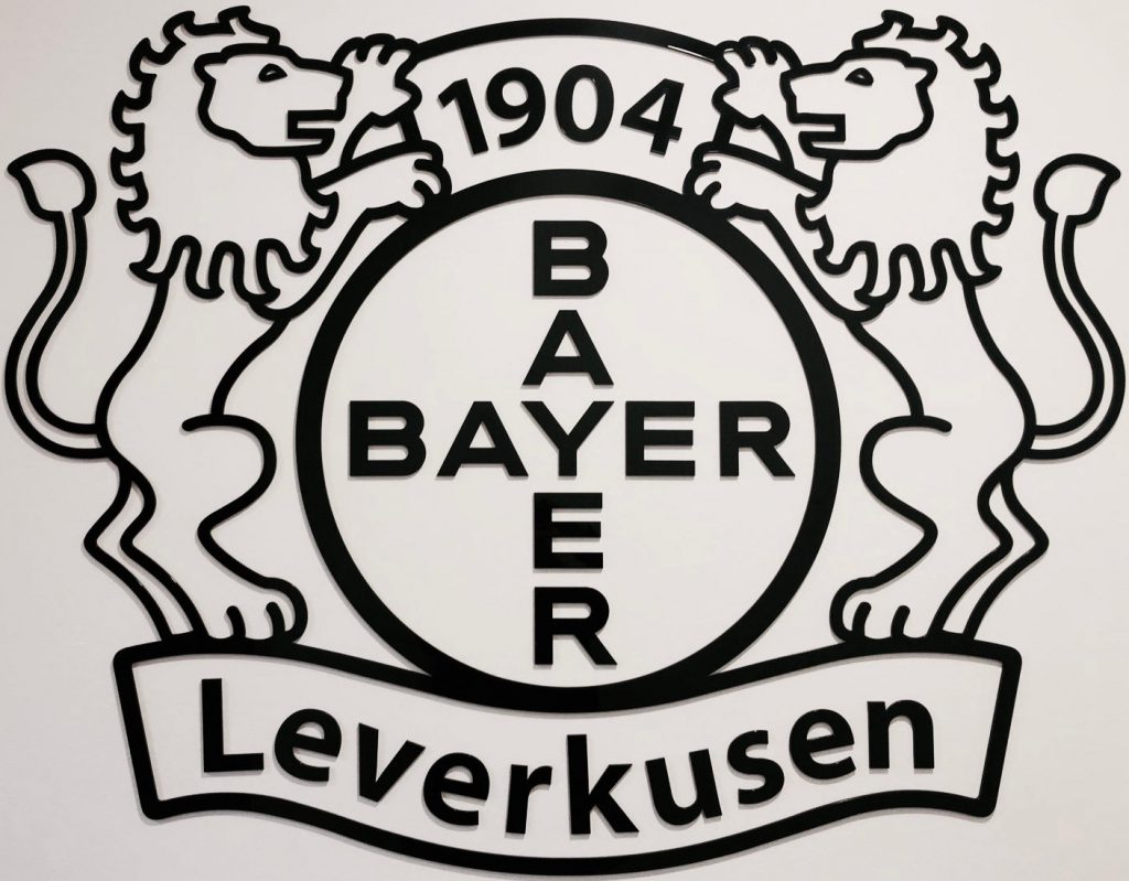 Two lions either side of the Bayer logo