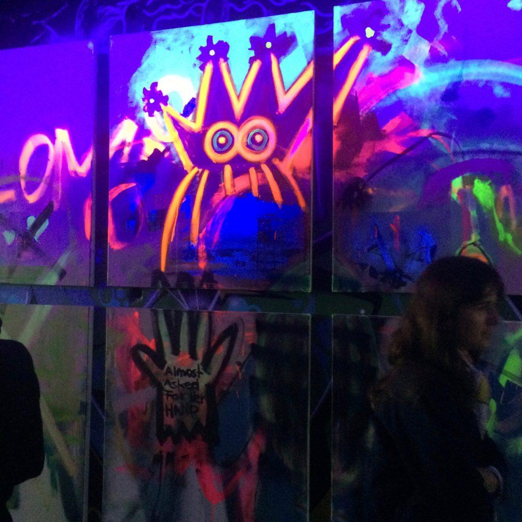 Graffiti art glowing in the dark at Stadtrevue, Cologne