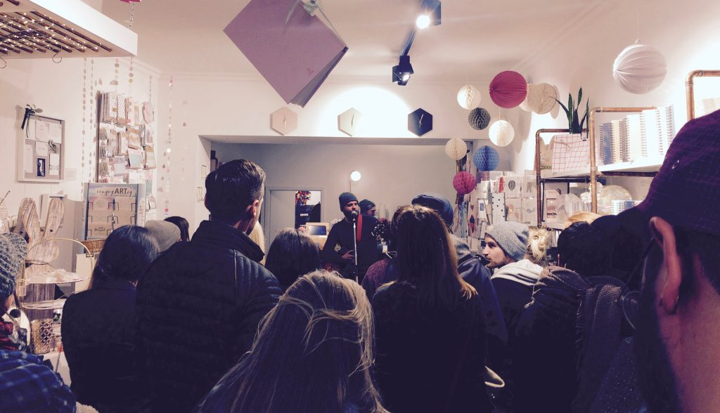 Crowd packed into the Fawntastic shop, watching Wallace Water sing