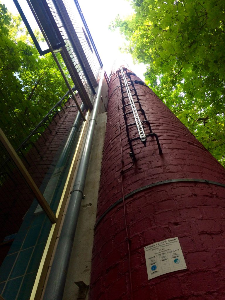 Red brick chimney viewed from the base at Paeffgen, Cologne
