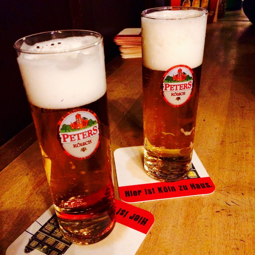 Close-up of two full Peters Kölsch Glasses on Peters beer mats