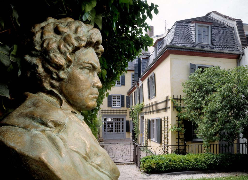 The courtyard of the Beethoven House in Bonn with a bust of Beethoven