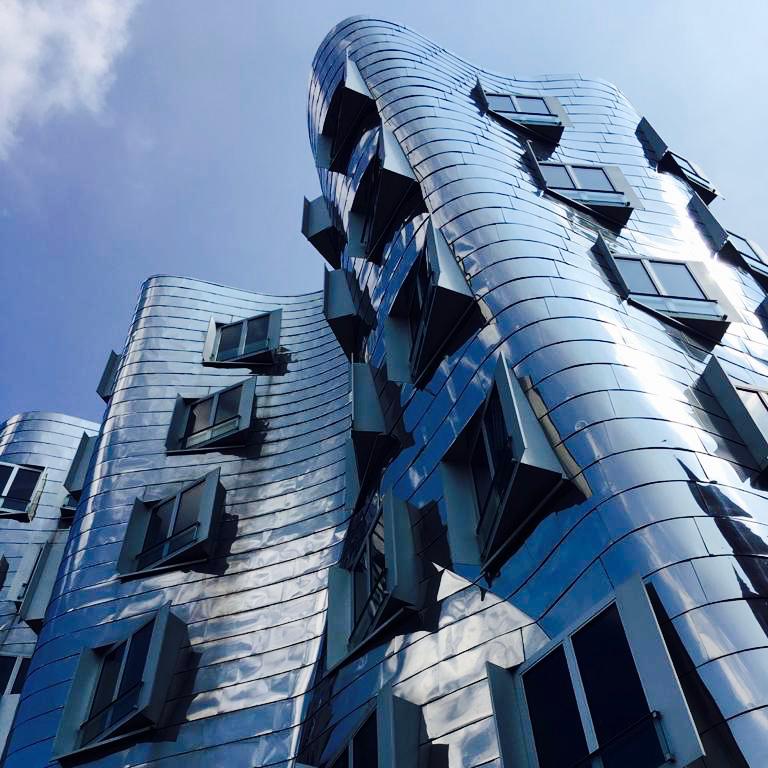 Silver wavy reflective Gehry buildings in Düsseldorf 2