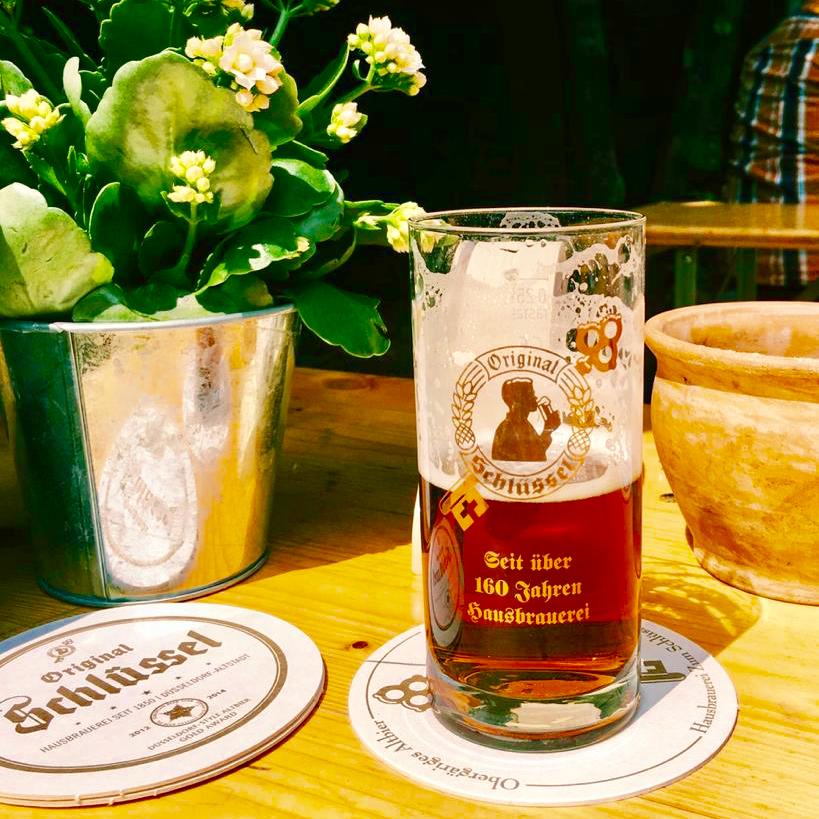Half full Altbier glass in Düsseldorf