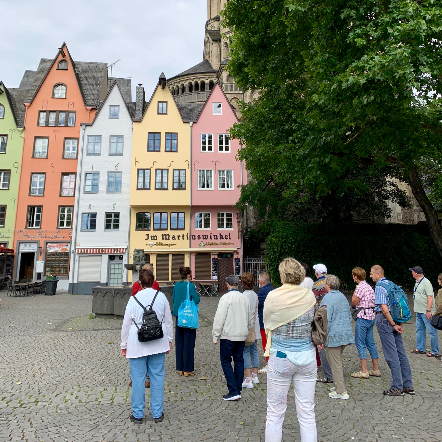 Tour guide leading a walking group through the old town, Cologne
