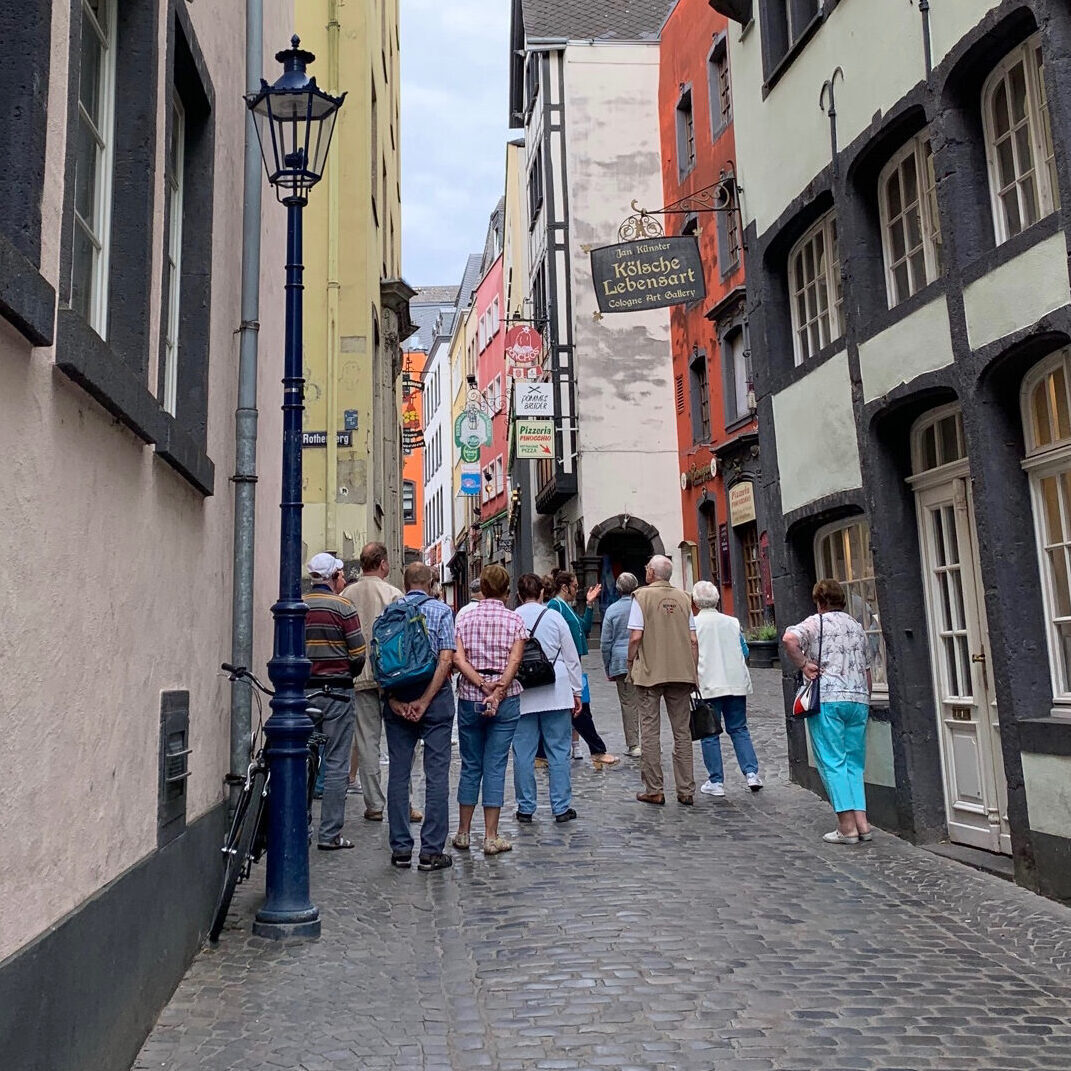 Walking tour group heads into the Altstadt Cologne